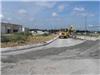 New curb and subgrade preparation looking west along Port Union