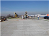 Crews stand on the finished bridge deck to pour the forward approach slab