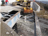 Disassembling the concrete deck as part of the rehabilitation of the old bridge