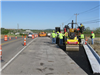 New asphalt is put down along Port Union Road facing the Bypass