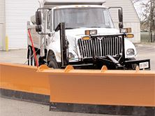 Large plow with orange plows