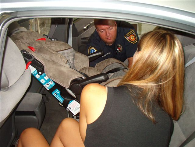 Firefighter Conducting a Child Safety Seat Inspection