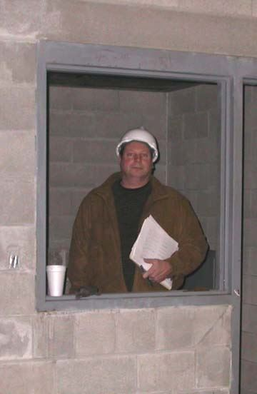 Man standing with paper work in construction zone