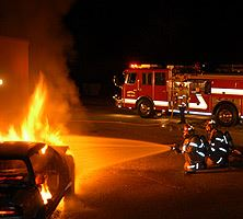 Firefighters Extinguishing a Car Fire